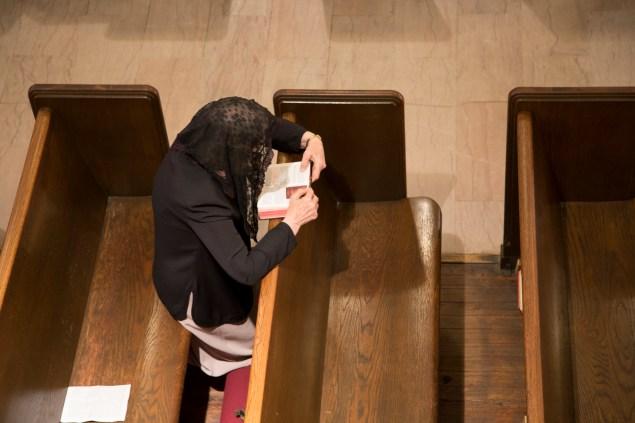 A parishioner deep in prayer (Photo by Kaitlyn Flannagan)