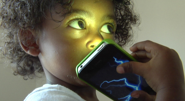 Mobilize asks us to consider what electromagnetic radiation might do to kids growing up with devices. (Photo via Mobilize)