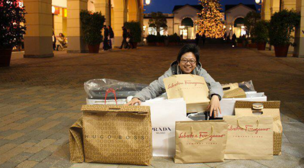 Another photo of Steve Tan with a pile of designer shopping bags. (Photo via Facebook)