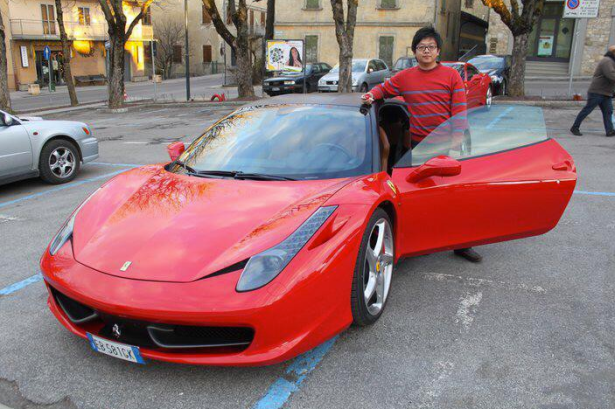 Kreyos cofounder Steve Tan with a new Ferrari. The photo was allegedly pulled off of his personal Facebook account before he kicked up his privacy settings and scrubbed clean all affiliations with Kreyos. (Photo via Facebook)