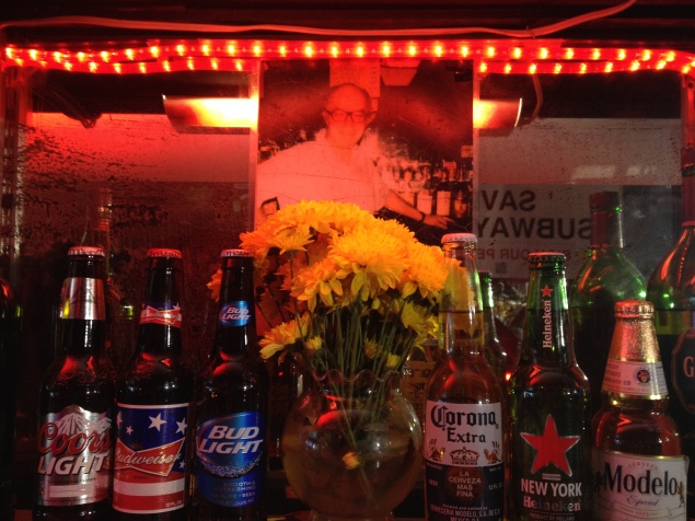A portrait of the bar's first owner, Charles Ackerman, still hangs behind the bar. (Photo by Emma Hernandez)