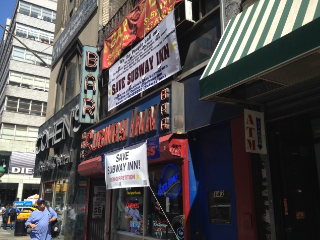 Subway Inn still displays its original neon sign, shining since 1937 on the corner of 60th and Lexington. (Photo by Emma Hernandez)
