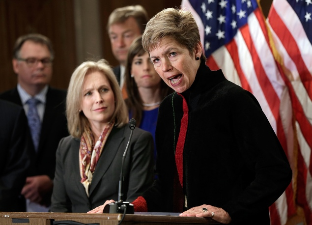 Retired U.S. Army Brig. Gen. Loree Sutton, at right, at a 2013 news conference with Sen. Kirsten Gillibrand. (Win McNamee/Getty Images)