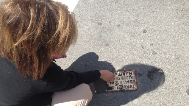 The unveiling of the new Toynbee Tile. (Photo by Tribeca Film Festival)