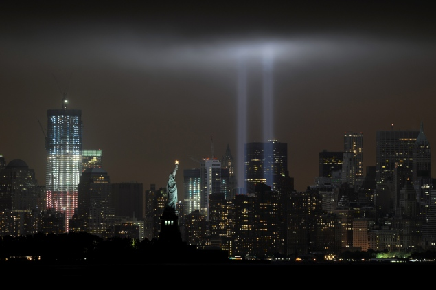 """The annual """"Tribute in Light """"memorial echoing the twin towers of the  World Trade Center illuminates the night sky. (Photo by STAN HONDA/AFP/Getty Images)"""