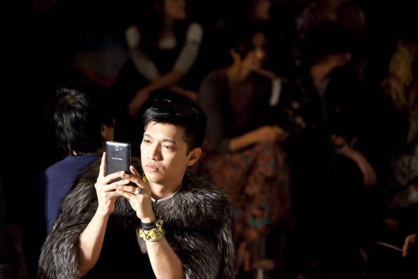 Bryanboy snaps a photo at the Costello Tagliapietra show in 2012. (Photo via Getty)