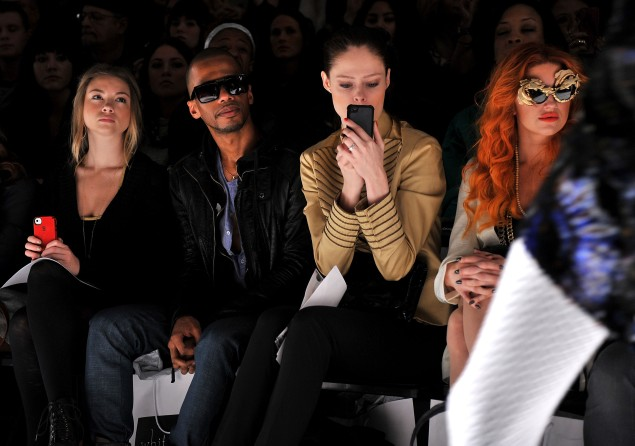 Ms. Rocha snaps a photo from the front row of the Fall 2012 Whitney Eve fashion show. (Photo via Getty)
