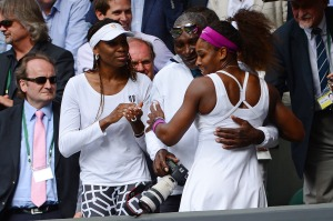 Serena Williams embraces her father and sister venus following her 2012 victory in the Wimbledon women's singles final. (Photo: Leon Neal/Getty)
