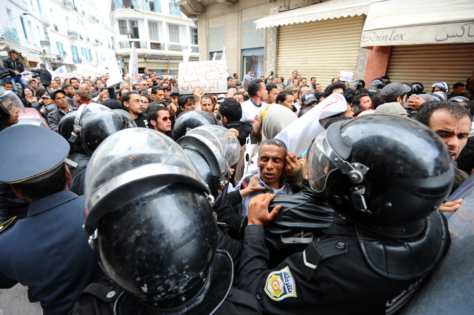 Police officers prevent unemployed Tunisians from protesting Ennahdha's Government, in Tunis on April 7, 2012.  (FETHI BELAID/AFP/GettyImages)