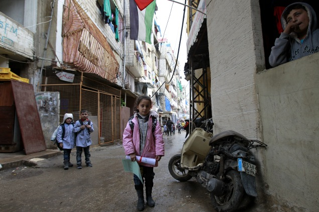 A Palestinian girl from the Syrian refugee camp of Yarmuk stands in a street at the Shatila refugee camp in the Lebanese capital Beirut. (Photo by ANWAR AMRO/AFP/Getty Images)
