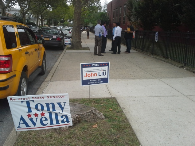 Dueling signs. (Photo: Ross Barkan)