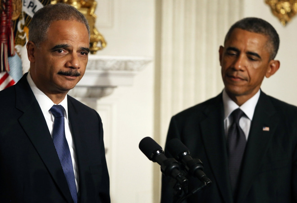 Attorney General Eric H. Holder Jr. joins President Barack Obama while announcing his resignation, September 25, 2014 in Washington, DC. (Photo by Mark Wilson/Getty Images)