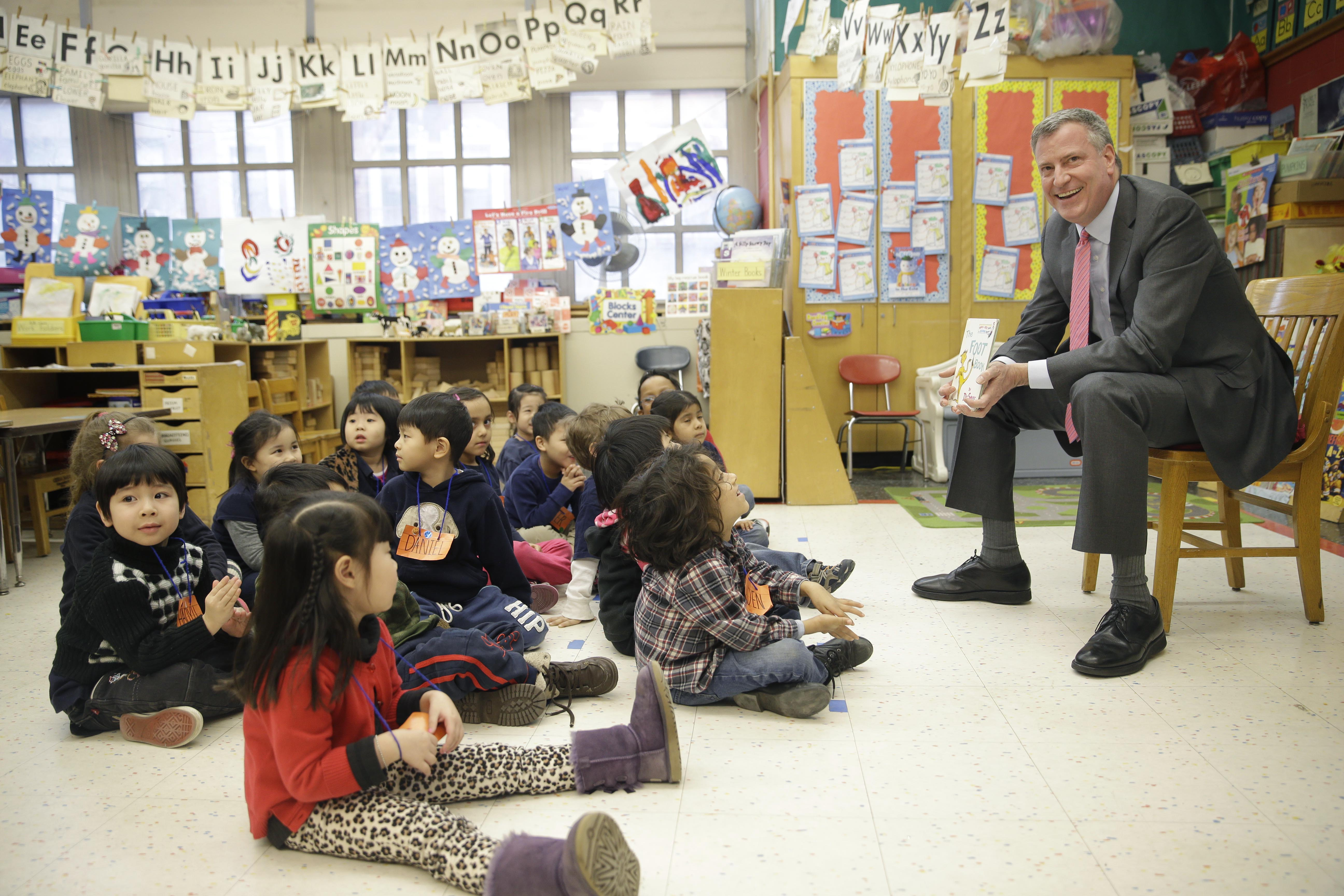 Bill de Blasio talking with pre-K students. (Photo by Seth Wenig-Pool/Getty Images)