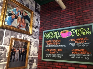Central Perk chalkboard menu and photos of Friends cast.