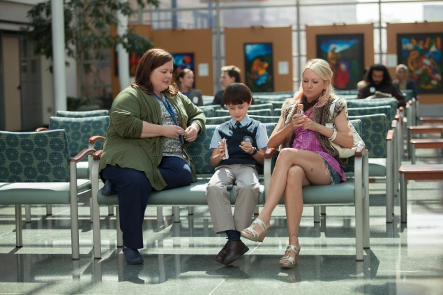 """In St. Vincent, Melissa McCarthy, left, fits into her first """"straight"""" role, and it's nice to see her without her usual vulgarity."""