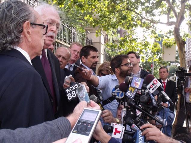 Lawyer Sanford Rubenstein and Dr. Michael Baden speak to a crowd of reporters about Eric Garner's death. (Photo: Jillian Jorgensen)