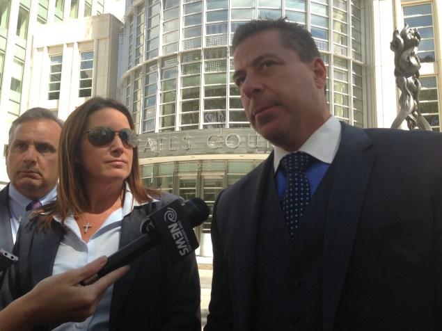 Lawyer Joseph Sconzo, Diana Durand, and lawyer Stuart Kaplan outside a Brooklyn federal courthouse. (Photo: Jillian Jorgensen)