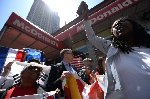 Fast-food workers protest in New York City in May. (EMMANUEL DUNAND/AFP/Getty Images)