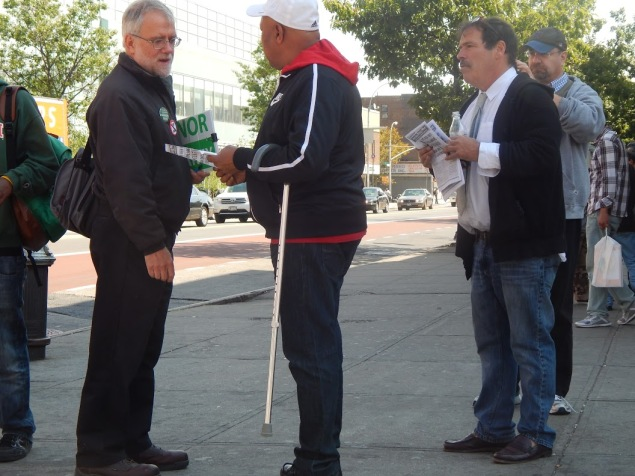 Howie Hawkins and Randy Credico talk to voters at 125th Street and Lexington Avenue (Photo: Will Bredderman).