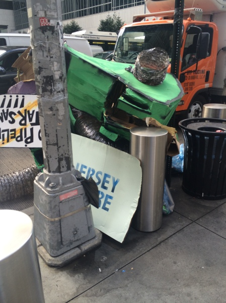 The corner of Sixth Avenue and 43rd street was left strewn with litter following Sunday's People's Climate March