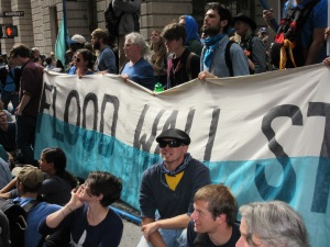 Protestors carried a banner to today's action (Photo: Will Bredderman).