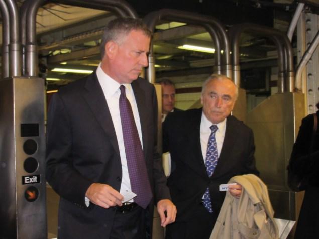 Bill de Blasio and Bill Bratton swipe their way into the City Hall station (Photo: Will Bredderman).