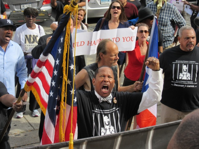 Andy King rallies outside the Bronx courthouse with reform activists (Photo: Will Bredderman).