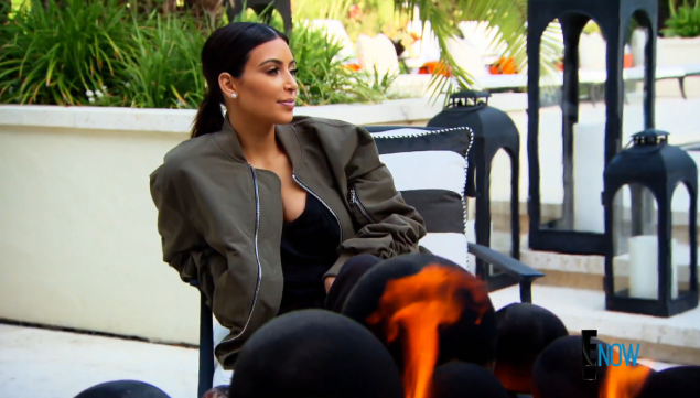 Kim's icy glare is no match for Bruce's industrial strength man-pony. But note the gas-fueled firepit symbolizing her inner hatred for her less chic family members. (Photo via E! Online)