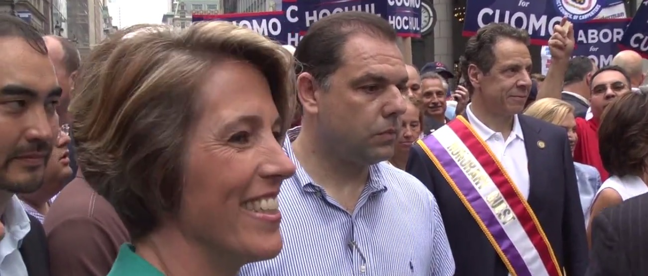 Zephyr Teachout blocked by Gov. Andrew Cuomo lieutenant Joseph Percoco while attempting to speak to the governor at a parade.