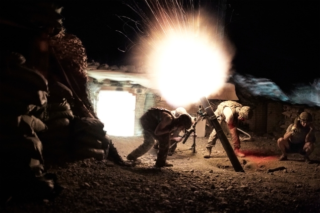 US Army soldiers from the 10th Mountain  Division fire mortar rounds from their Combat Outpost during a surprise attack by Taliban fighters. AFGHANISTAN. Kunar, 2012. (Photo by Sebastiano Tomada)