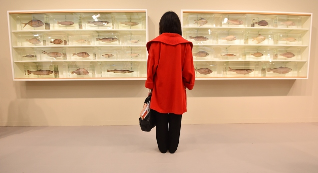 A woman at the Frieze Art Fair in London. (Courtesy Getty Images)