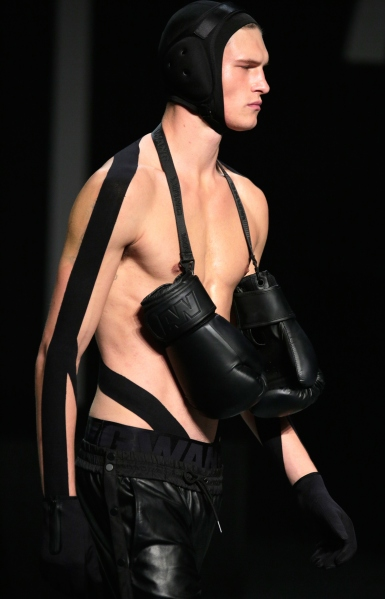 A model walks the Alexander Wang x H&M runway. (Photo via Getty)