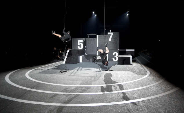 The runway, with parkour performers being lowered down just before their performance. (Photo via Getty)
