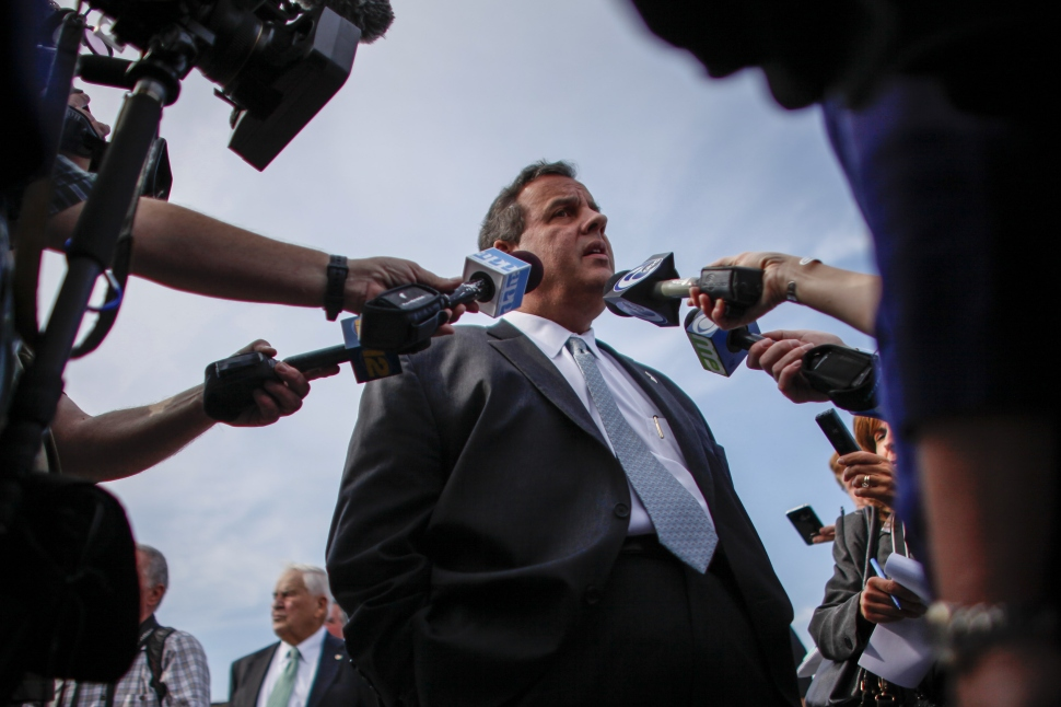 New Jersey Governor Chris Christie talks with members of the media as he visits the East Dover marina two years after Hurricane Sandy on October 29, 2014 in Toms River, New Jersey (Photo by Kena Betancur/Getty Images).