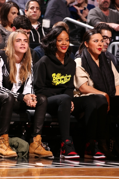 Cara Delevingne with Rihanna at a Brooklyn Nets game. (Photo via Getty)
