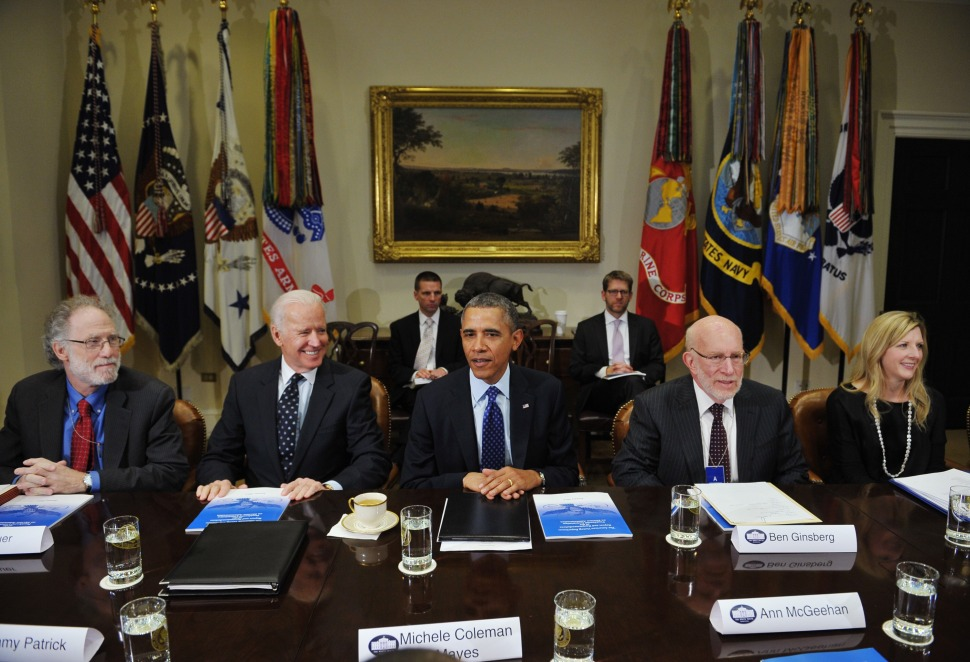 US President Barack Obama and Vice President Joe Biden in the White House in January, 2014, joined by Counsel Kathy Ruemmler and others. (MANDEL NGAN/AFP/Getty Images)