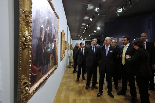 French Foreign Minister Laurent Fabius (3rd-R) and his Emirati counterpart Prince Abdullah bin Zayed al-Nahyan (2nd-R) visit the 'Birth of a Museum' exhibition in the Louvre Museum in Paris on May 9, 2014. (Photo by Francois Guillot, courtesy Getty Images)