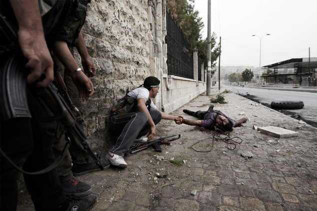 Free Syrian Army fighters attempt to save the life of a civilian severely wounded by a Syrian Army sniper along one of Aleppo's front lines.Aleppo, Syria. October 21, 2012. (Photo by Sebastiano Tomada)