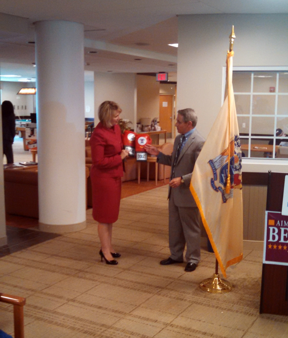 Belgard accepts a pair of boxing gloves -- or endorsement -- from Philip Rotondi of the National Committee to Protect Social Security.