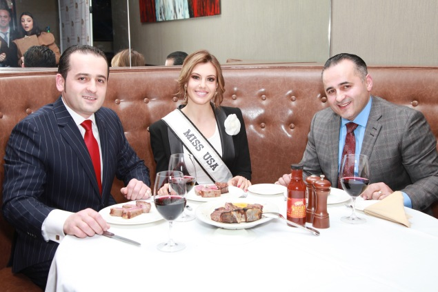 Jeff and Jack Sinanaj with Miss USA 2013 Erin Brady at an Empire Steakhouse opening. (Patrick McMullan)