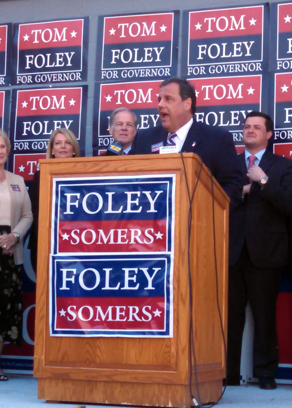 Christie addresses a crowd of Republican supporters outside a Foley field campaign office in Trumble, CT.