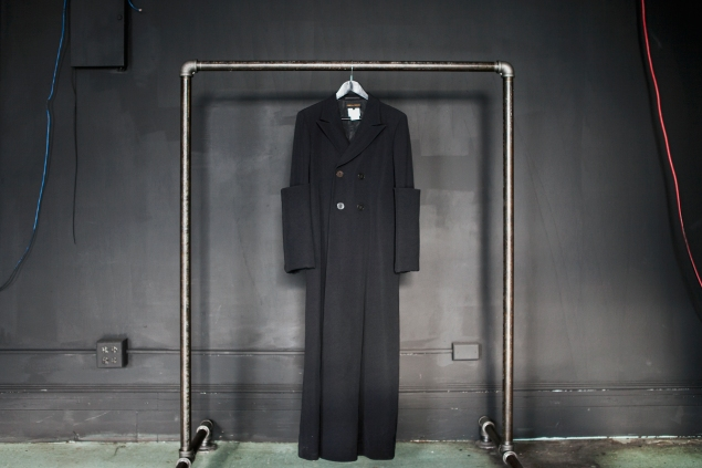A Comme des Garçons black coat from the 1990s at Byronesque.