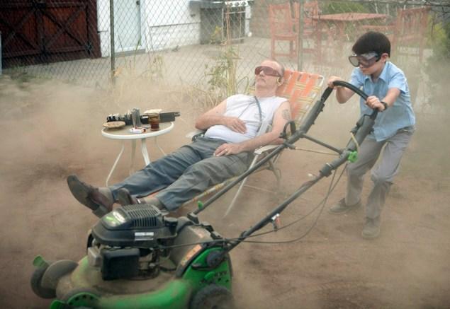 Bill Murray, left, and Jaeden Lieberher star in St. Vincent.