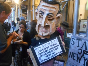 An anti-fracking protester wearing a Cuomo mask. (Photo: Ross Barkan)
