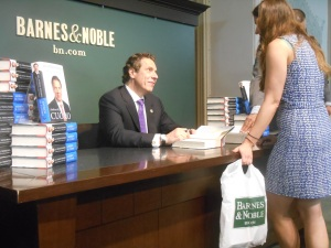 Mr. Cuomo signs a book for a fan. (Photo: Ross Barkan)