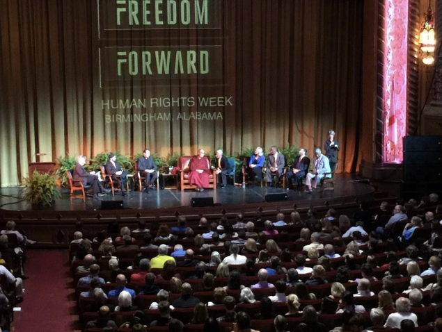 The Dalai Lama on stage with Rabbi Shmuley and others, including Imam Khalid Latif, Catholic priest Eric Andrews and Urban Ministries President Carl Jeffrey Wright.