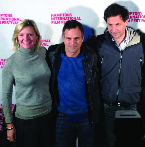 Executive director of the Hamptons International Film Festival Anne Chaisson with actor Mark Ruffalo and director Bennett Miller on the red carpet before a screening of Foxcatcher.