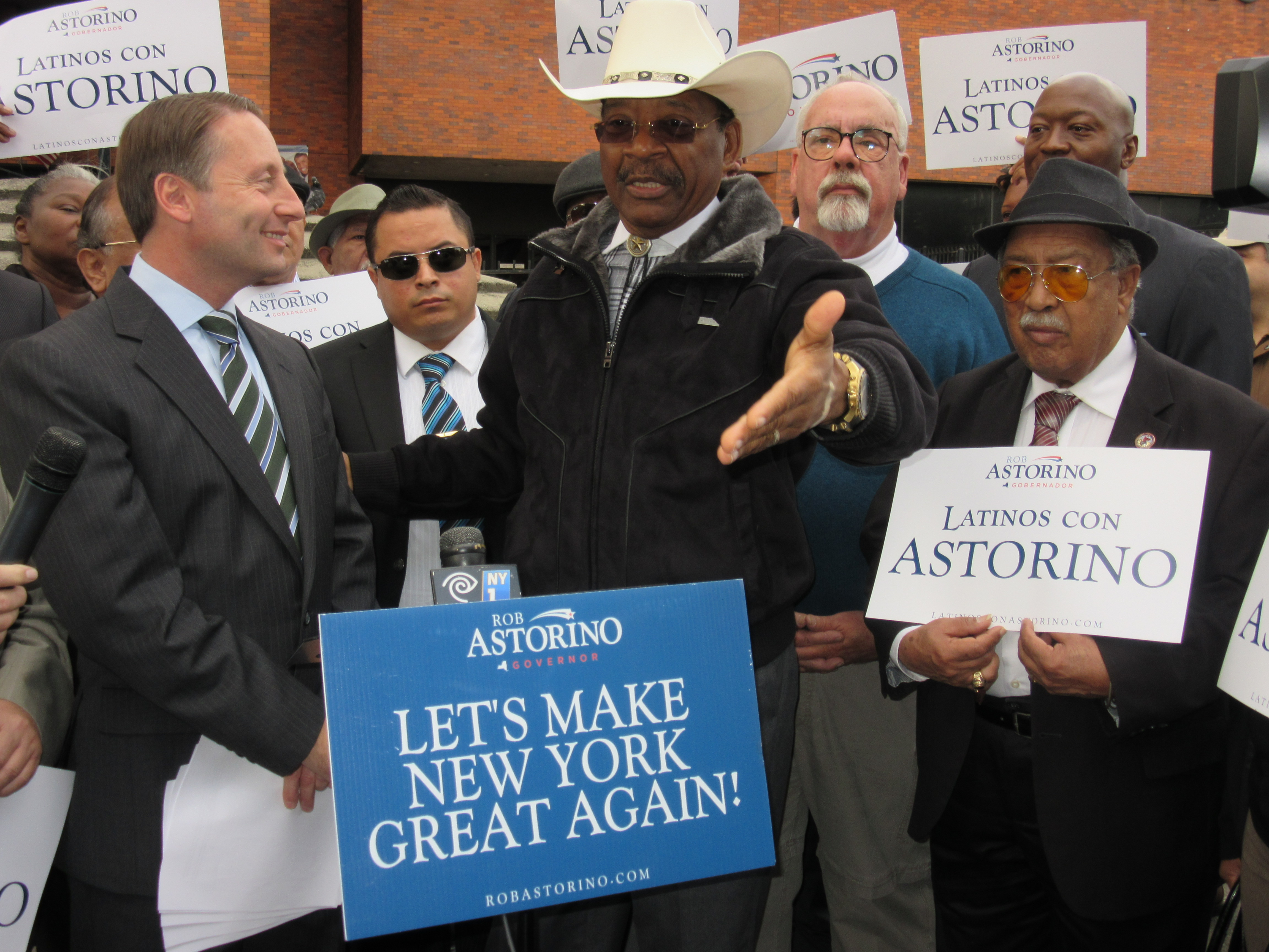State Senator Ruben Diaz Jr., center, presents Westchester County Executive Rob Astorino, left, surrounded by Hispanic pastors and former GOP comptroller candidate John Burnett, back right.