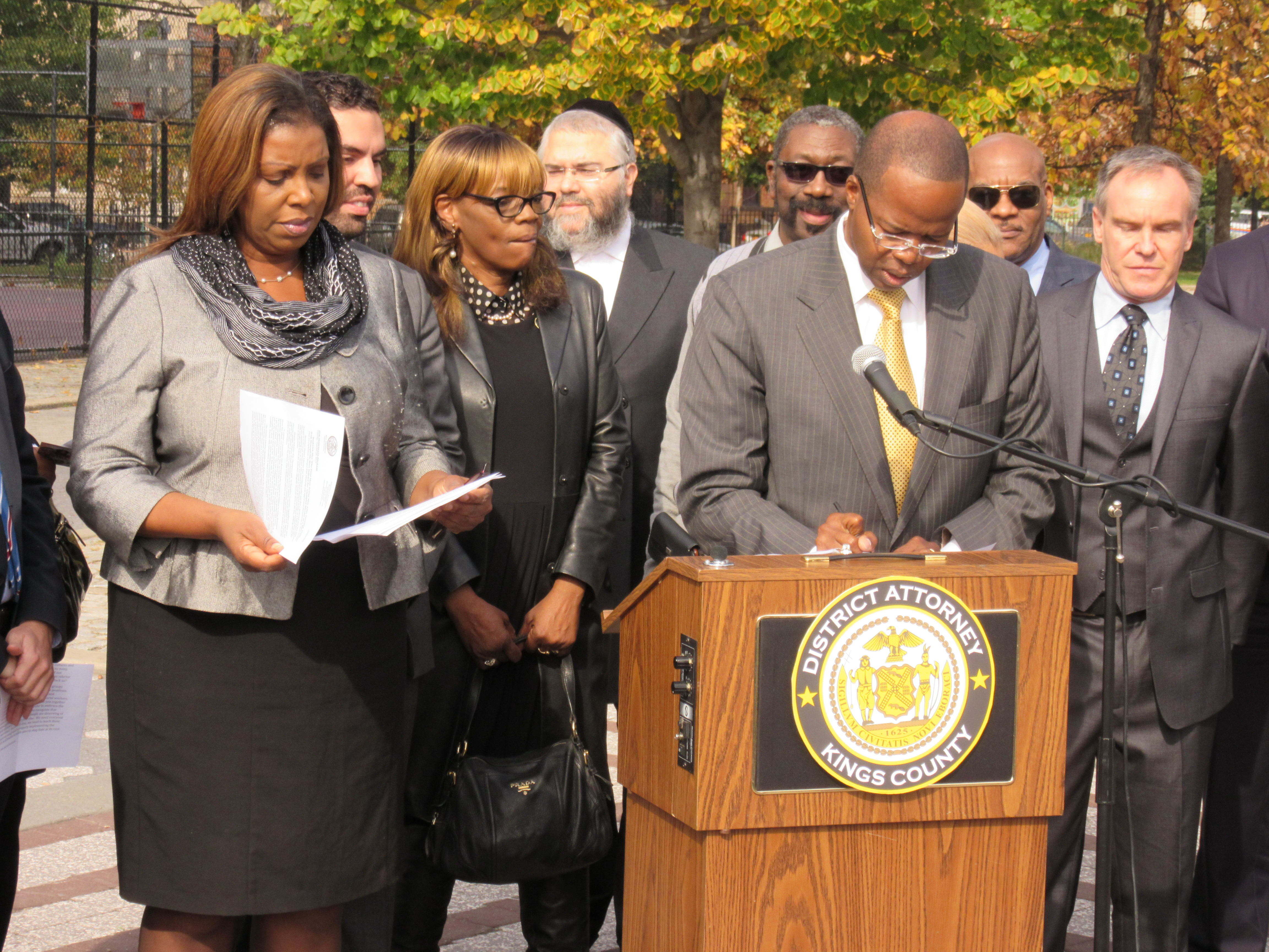 Public Advocate Letitia James, left, beside Brooklyn District Attorney Kenneth Thompson today (Photo: Will Bredderman).