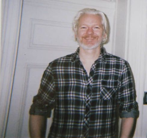 Assange with an Observer reporter in 2014.